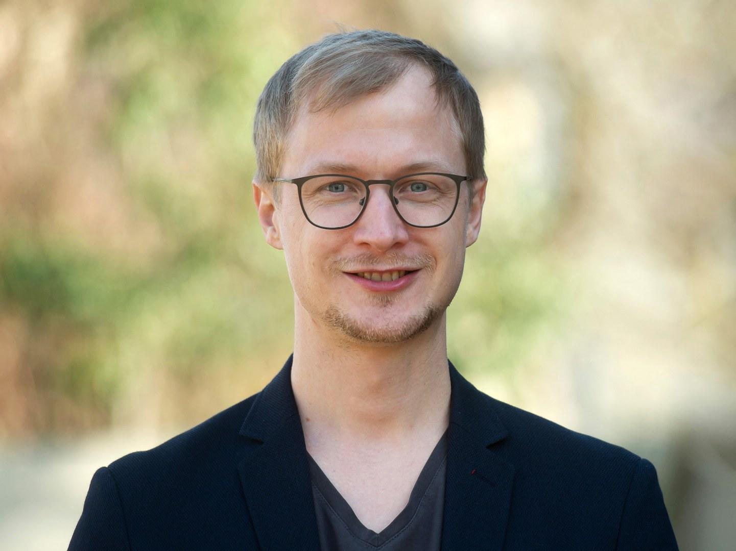 Dr. Michael Wustmans