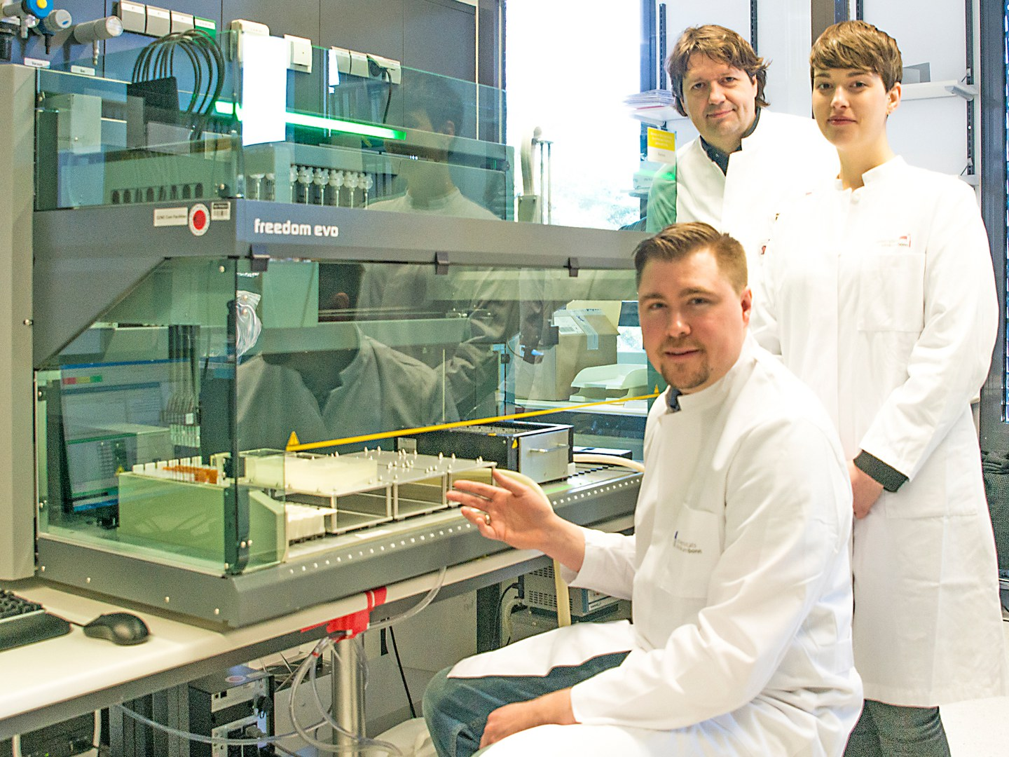 The research team at the pipetting robot